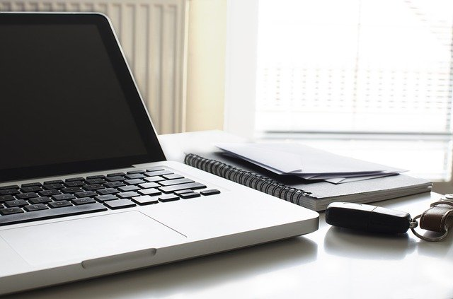 An open laptop computer sitting on top of a table