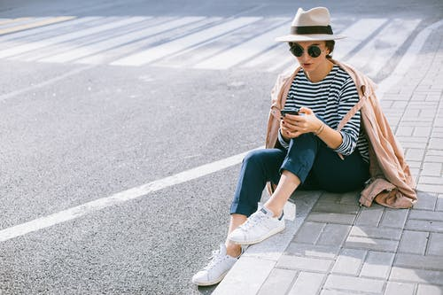 A person sitting on a street