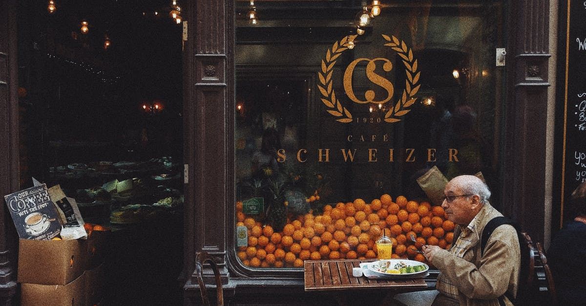 A group of oranges in front of a store